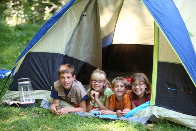 Portrait of children camping in tent